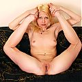 Playful blonde gets naked and shows off her amazing flexibility