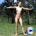 Girl does naked exercises in the open air